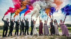 Wedding party with smoke bombs. Only would be red white and blue