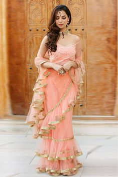 The most trending saree for any occasion is the hassle-free ruffle saree. These ruffle designed sarees are perfect for every occasion and should be just perfect to sort out your wedding season closet. Indian Designer Outfits, Indian Outfits, Designer Dresses, Designer Wear, Mehndi Outfit, Saree Blouse Patterns, Saree Blouse Designs, Saree Gown, Lace Saree