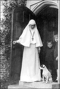 Grand Duchess Elizavetta Feodorovna with 2 boys & a Jack Russel Terrier. She became a Russian Orthodox nun following the death of her husband Grand Duke Sergei. Ella was sister to Alexandra-Tsarina of Russia.  Ella was assassinated by the Bolsheviks along with many other family members.  She is now a saint in the Russian Orthodox Church.