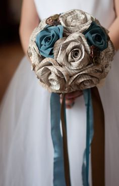 Carry your love of reading with you during your wedding. This bouquet is made of 15 roses made out of a mix of colored paper and book pages. All of the