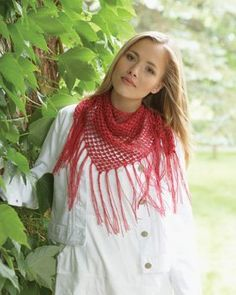 """Add this stunning triangle scarf to your accessory collection today. Bernat's Crochet Thread is used to work up this lightweight crochet scarf pattern. The fringe adds a delicate finishing touch to the Country """"Cowl"""" Girl Scarf."""