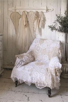 Vintage laces and doilies sewn together into a chair shawl