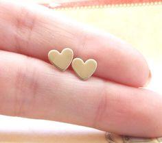 Tiny brass heart earrings. $5.25, via Etsy.