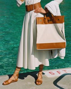 Inspired by vintage totes used to carry laundry, the Voyager bag elevates a utilitarian design. Sturdy Italian cotton canvas is accented with tan calfskin and our signature turn-lock for a luxe finish.