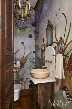 A fanciful mural-style wallpaper from Anthropologie adds panache to the petite powder room. Peacock Pavers, Architecture Tattoo, Atlanta Homes, Fall Is Here, Make Design, Beautiful Interiors, Beautiful Homes, Beautiful Bathrooms, Decoration