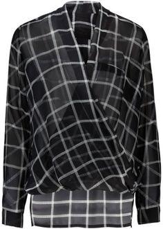 Guarda qui:Blusa in tessuto fluente a quadri, con scollo incrociato e taschino finto sul lato sinistro. Fondo allungato sul dietro e manica lunga risvoltabile. Lunghezza ca. 72 cm.