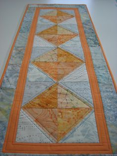 Quilted Table Runner--Melon and Dove Grey Batiks by VillageQuilts on Etsy