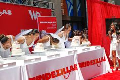 6/10/2013: Cake-eating contest for brides at @Dennis Jarmin's Bridezillas anniversary event. Photo: Seth Olenick/Grand Central Marketing