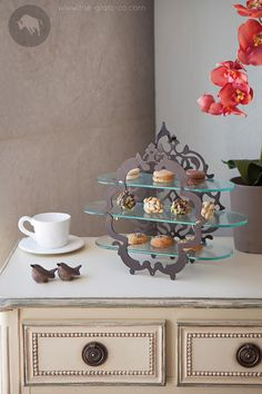 High Tea metal stand with arabesque design and three glass shelves, available in different colors. Perfect for lobby decoration, tea lounge, vip amenities presentation or afternoon tea at home! Designed by Glass Studio #Tea #HighTea #AfternoonTea #Stand