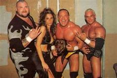 Triple Threat ECW. From left to right Bam Bam Bigelow, Francine, Shane Douglas, and Chris Candido.