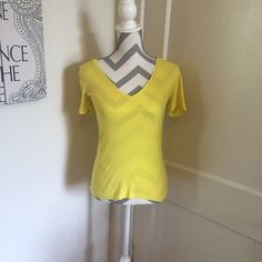 J. Crew yellow v neck J. Crew v neck Yellow  Size small Gently used Please ask for additional pictures, measurements, or ask questions before purchase No trades or other apps. Ships next business day, unless otherwise noted in my closet Reasonable offers accepted  Five star rating Bundle for discount J. Crew Tops Tees - Short Sleeve