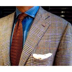 Brown knit tie, denim shirt, prince of Wales blazer