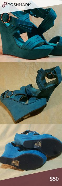 "NWOT Gorgeous Teal Strappy Tall Wedge Sandal NWOT. Very sexy summer platform wedge in a beautiful teal micro suede. Unique strap details. Stunners! Wedge Approx. 5"" at highest point, platform approx. 1.5"". Never worn. Paprika Shoes Wedges"
