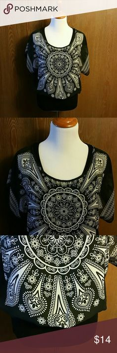 FANG Boho Style Chiffon Top Size Large NWT 🛍💖 NWT Size Large.  FANG drapey chiffon top in black and  cream with flower/heart design. It has a built-in cami that is the black fitted bottom of the top.  The chiffon portion drapes over the top of that. It's very soft and flowy.  Very pretty! Fang Tops Blouses