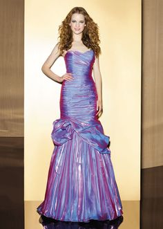 Love 16 style P12089 has is soft shine organza gown with asweetheart neckline with a fitted ruched bodice, floral detail on mermaid skirt and a corset back.