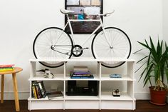 Bike Rack Furniture is Perfect for Tiny Apartments and Dorm Rooms: Bike Storage Furniture: A Double Duty Bookcase Bike Storage Furniture, 70s Furniture, Bicycle Storage, Furniture Plans, Furniture Design, Bicycle Rack, Bike Storage Apartment, Bike Hanger, Bike Room