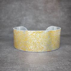 A beautiful gold and silver cuff!  Jennascifres.etsy.com