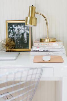 modern desk vignette with brass touches