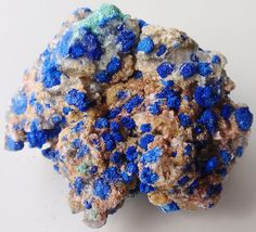 Beautiful  azurite crystal rosettes associated with siderite and malachite , Lavrion , Greece