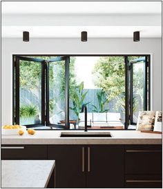 Bi-fold windows are perfect for a servery. A simple way to bring a café-like feel to your living areas. window : Bi-fold windows are perfect for a servery. A simple way to bring a café-like feel to your living areas. Home Decor Kitchen, Interior Design Kitchen, Kitchen Decorations, Kitchen Window Bar, Kitchen Windows, Kitchen Window Designs, Wall Of Windows, Modern Window Design, Window Over Sink