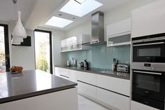 White Grey Handleless Kitchen designed and installed by LWK Kitchens London - a leading supplier of bespoke German kitchens for London.