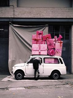 Lovin' the pink parcels. And the heels. And the car.