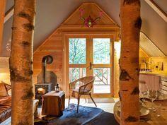 De houten huisjes van Les Cabanes de Rensiwez, in de Belgische Ardennen, zijn zo mooi, daar wil je nooit meer weg.