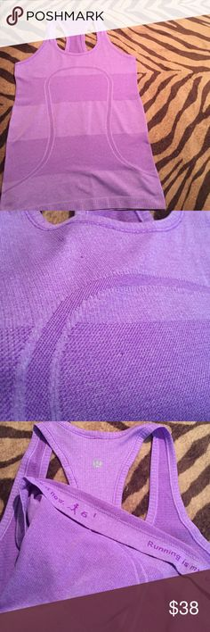 Lululemon swift size 6 purple Used swift racer tank in size 6, this top has two small snags shown in second photo. lululemon athletica Tops