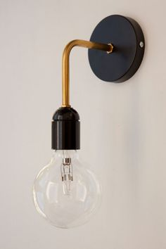 Brass wall sconce with black Bakelite lamp holder – sculptural brass wall or ceiling lamp by leola lamp…shop plate brass wall sconce designed by mermelada…myrtle modern solid brass wall sconce with… Luminaire Mural, Deco Luminaire, Luminaire Design, Home Lighting, Modern Lighting, Cosy Bathroom, Kids Lamps, Metal Walls, Wall Design