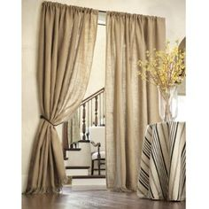 These are Burlap Curtains...I love the idea of this and would use a tie from a Bale of Hay as tie backs!
