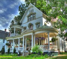 Love Victorian style houses with the porches all the way around.!