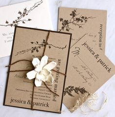 Taupe recycled paper, cream envelopes, burlap liner, twine and flower wedding invitations sets.