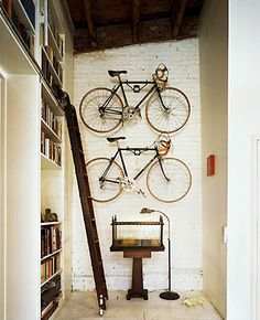 bikes as art - great idea for my husbands budding collection.  personally i love the rolling library ladder...