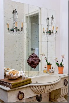 Loving the tiled mirrors in powder room.  Brilliant!  Amy Howard's home in Memphis