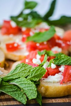 Mint and Goat Cheese Bruschetta -- a small twist on the classic basil version (although we love to swap out the mint for basic from time to time with this recipe) -- perfect for fall entertaining