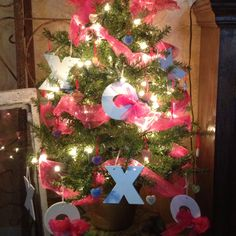 Valentines tree!!  X's and O's are  ceramic christmas ornaments discounted 90% from hobby lobby!