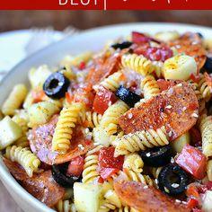 The BEST Pasta Salad Recipe Salads with gluten-free pasta, roma tomatoes, cucumber, pepperoni, sliced olives, salad, italian salad dressing