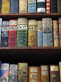 This picture on prettybooks.com is titled:  Books inside the Prague Castle museum.  Aren't they beautiful?  I wonder what the numbers mean.....classification, number of volumes?