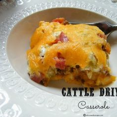 Cattle Drive Casserole: 1 1/2 lbs ground beef  3/4 cup onion, diced  1 bell pepper, diced  1 taco seasoning packet  1/2 cup sour cream  1/2 cup mayonnaise  1 cup cheddar cheese, shredded & divided  1 sm. can (4 oz) diced green chilies  1 (10 oz) can Rotel diced tomatoes with green chilies  2 cups Bisquick  1 1/4 cup water, divided