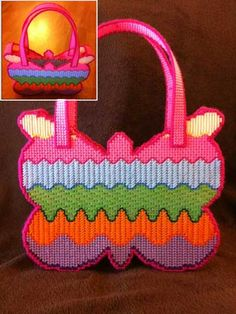Butterfly Purse Plastic Canvas Pattern Download from e-PatternsCentral.com -- This rainbow-colored butterfly purse is a whimsical piece that you can carry around this summer.