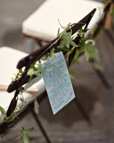 Sandalwood fans and a vine of ivy hung from the cushioned bistro chair backs alongside the programs. The seating was arranged in a circle around the happy couple.