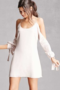 A satin slip dress featuring an open-shoulder design, cami straps, long sleeves with self-tie cuffs, scoop neckline, and a concealed back zipper. This is an independent brand and not a Forever 21 branded item. (This item runs large, please size down.)