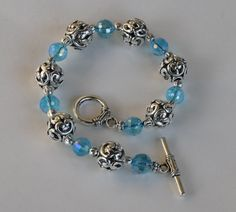 Silver Plated Tibetan Heart Carved Beads with Aquamarine Faceted Crystal Beads Bracelet with Silver Plated Toggle Clasp.  8 inch bracelet.