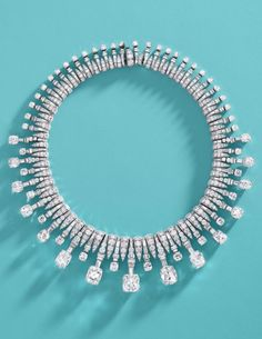 An Extremely Rare And Impressive Art Deco Diamond Necklace, by Bulgari, Circa 1935. Set with 15 cushion-shaped diamonds graduating in size to the front, alternating with smaller, similarly cut diamond terminals on baguette-cut diamond batons, accented and spaced by brilliant-cut diamonds, signed Bulgari, length 38.3cm. #Bulgari #ArtDeco #necklace