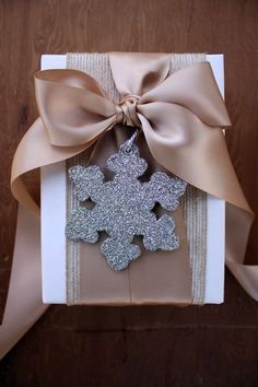 Snowflake detail on gold gift wrap.