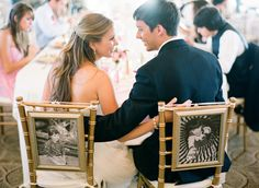 cute idea- childhood pictures of bride/groom on back of chairs