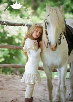 Little girl dressed in white with her white horse