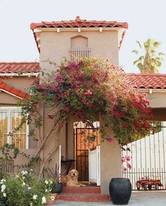 """The 1934 Spanish-style home in Los Angeles is dominated by shades of white -- which may seem counterintuitive for a house with children -- but Amy insists """"everything is machine-washable. Spanish Style Homes, Spanish House, Spanish Colonial, Spanish Design, Spanish Exterior, Spanish Modern, Spanish Tile, Spanish Revival, House Roof"""