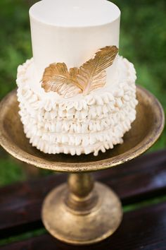 ruffled cake with gold feather accent