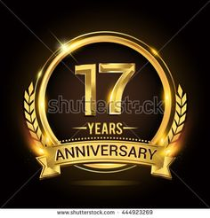Celebrating 17 years anniversary logo with golden ring and ribbon, laurel wreath vector design. - stock vector